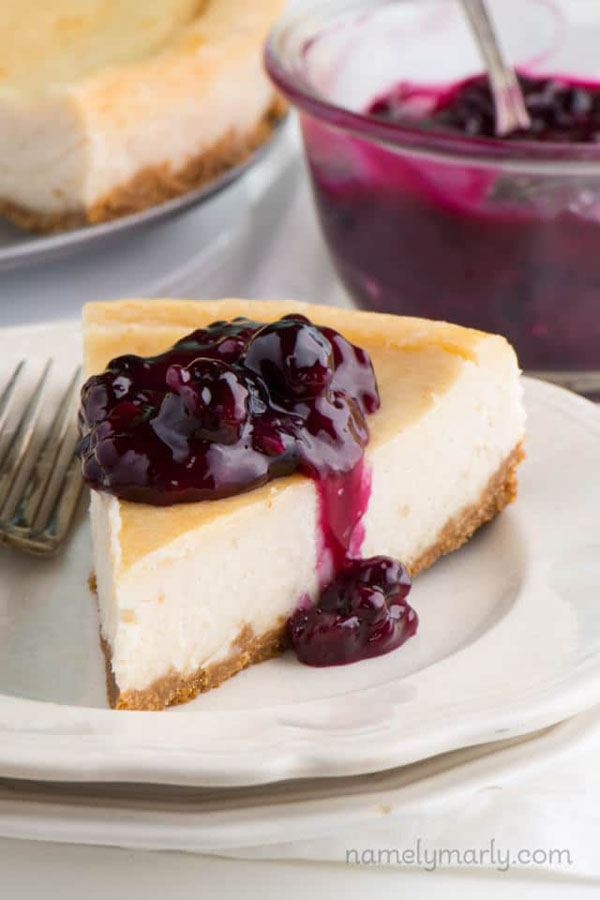 New York-style cheesecake topped with berry compote