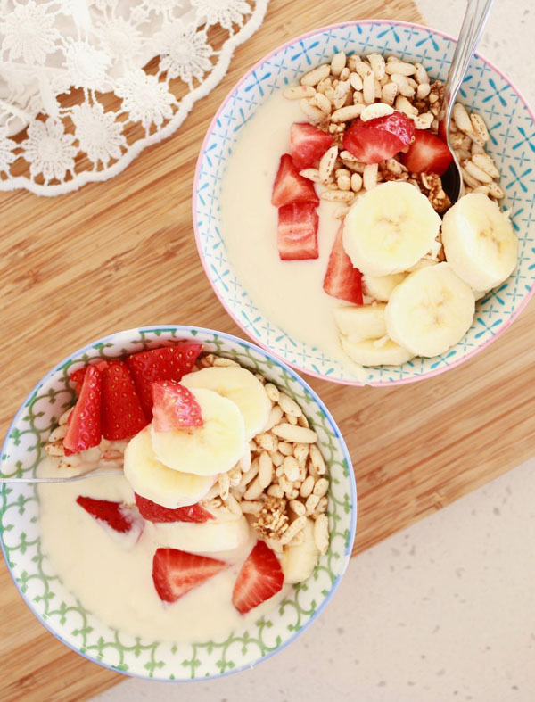 Bowls of vegan yoghurt topped with fruit