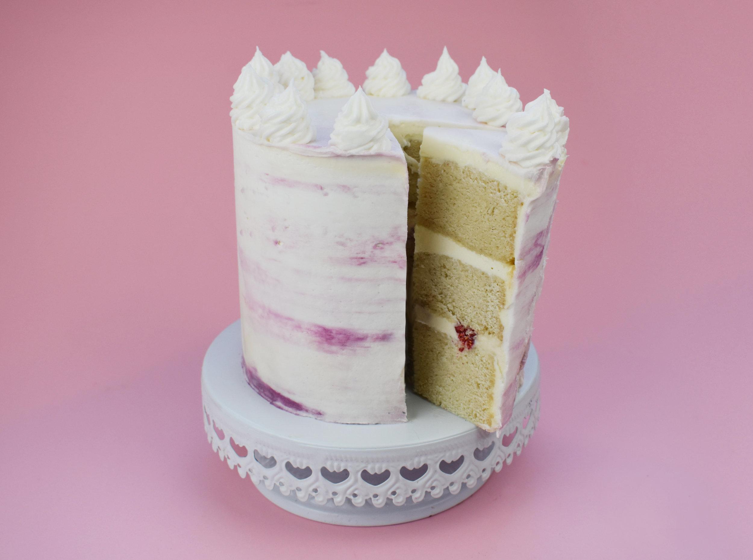 vegan White Chocoholic Mud Cake with Buttercream and Raspberries