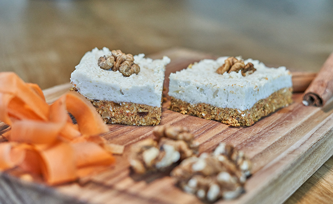 Raw vegan carrot cake with creamy frosting